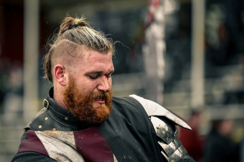 Blood trickles down the nose of a member of the USA Knights after a fight during the Armored Combat League U.S. National Championship. (Photo by Kyle Elsasser)