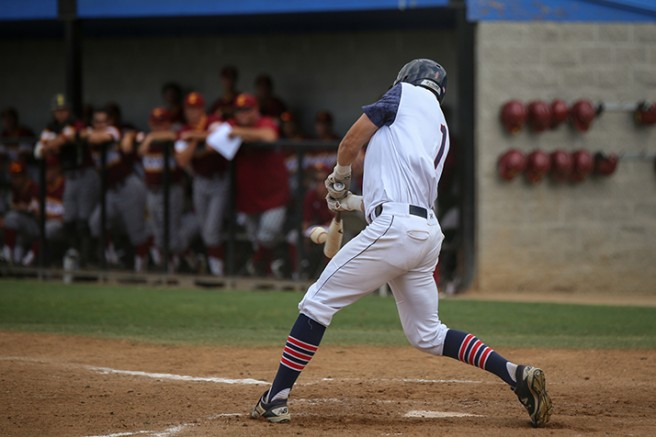 American River College right fielder Cade Parker hits the ball during a game vs Sacramento City College on April 21 2016 at American River College. ARC lost by the final score of 7-3. (Photo by Kyle Elsasser)