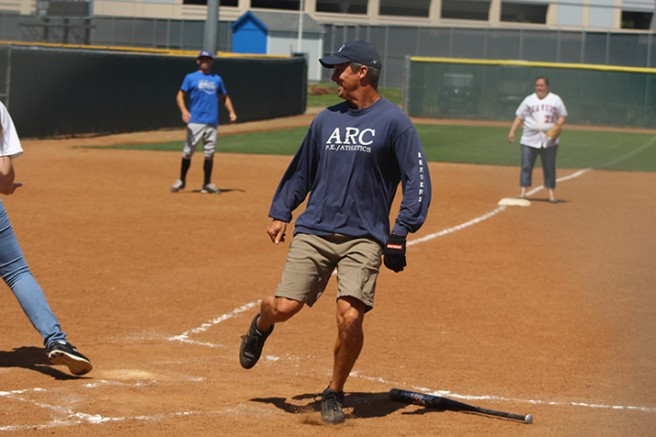 Men's track and field head coach and Faculty player Rick Anderson looks back after scoring a run during the Classified vs. Faculty softball game on April 29, 2016 at ARC. Faculty won the game 24-9. (Photo by Mack Ervin III)