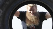 Allan Thrall flips a tire that weighs 440 pounds. Thrall is the owner of Untamed Strength, a gym that specializes in strongman training.  (Photo by Bailey Carpenter)