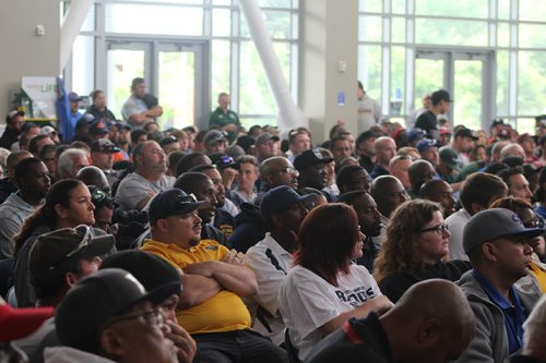 Audience members look on as Denver Broncos offensive line coach Clancy Barone gives the keynote speech at the Linemen Win Games (LWG) coaches clinic on May 21, 2016 at American River College. Hundreds of line coaches and youth football coaches filled the Student Center to listen to the Super Bowl champion coach. (Photo by Mack Ervin III)