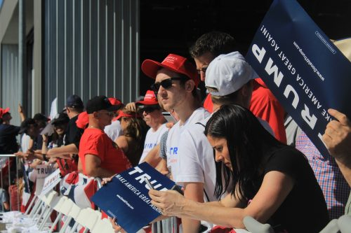 Donald Trump supporters lined up at the front of the crowd waiting for Trump to arrive and give his speech. (Photo by Jordan Schauberger)