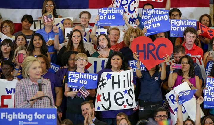 Hillary Clinton supporters hold up signs during Clinton's campaign event at Sacramento City College in Sacramento, California on June 5, 2016. (Photo by Kyle Elsasser)