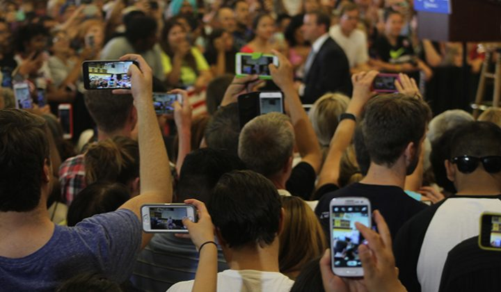 Supporters of Hillary Clinton record Clinton's speech on their phones during a rally event at Sacramento City College on June 5, 2016. Clinton took the stage to much applause and cheers from the crowd. (Photo by Mack Ervin III)