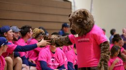 """""""The Beaver,"""" American River College's new mascot, high fives a scholar athlete at the fall sports preview on August 26, 2016. (Photo by Kyle Elsasser)"""