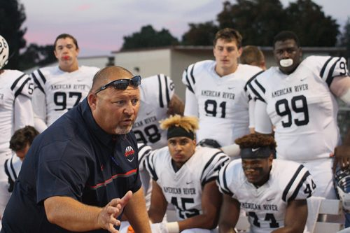 Amerrican River College defensive coordinator Lou Baiz talks to the players following ARC's 23-20 win against Diablo Valley College n Friday Sep. 1 at DVC. ARC allowed 324 yards during the game. (Photo by Lao Broadway)