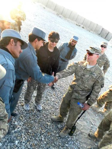 Qais Ahmad (center) translates for first lieutenant Spinelli (right) of the 327th Alpha Company and Afghan Police (left) after a combat and manevaor training in Fob Connolly. (courtesy of Qais Ahmad)