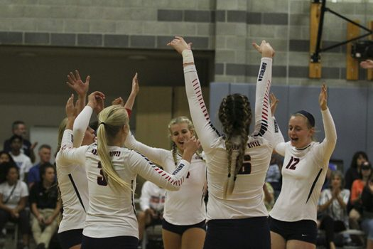 ARC's women's volleyball team celebrates after they make another score against SRJC on Sept. 24. ARC won 3-0. (Photo by Laodicea Broadway)