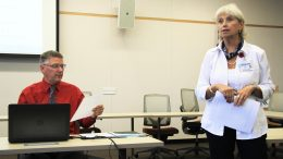 Professor Julie Blaney (right) gives her proposal for creating a Certified Nurse Assistant & Home Health Aid department separate from the Nursing Department to the board of the American River College Academic Senate as President Gray Aguilar (left) reads the proposal at their September 8, 2016 meeting. (Photo by Robert Hansen)