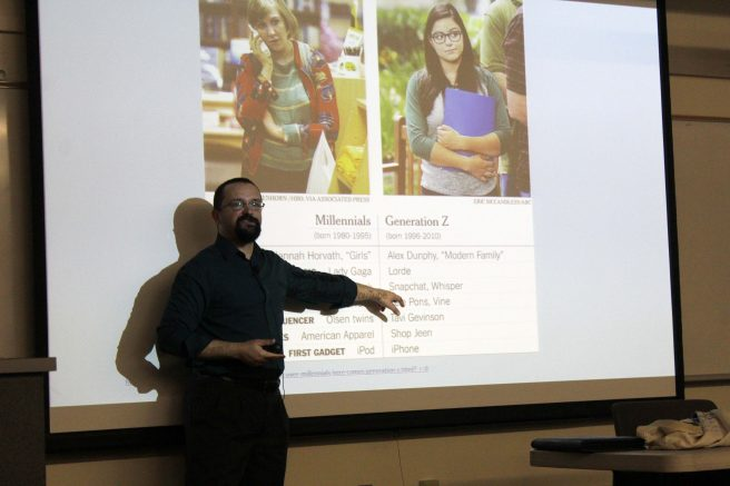 Carlos Reyes, Dean of behavioral & social science, discusses trends of millennial and generation y students at a College Hour in Raef Hall 160 on Sept, 20, 2016. (Photo by Robert Hansen)