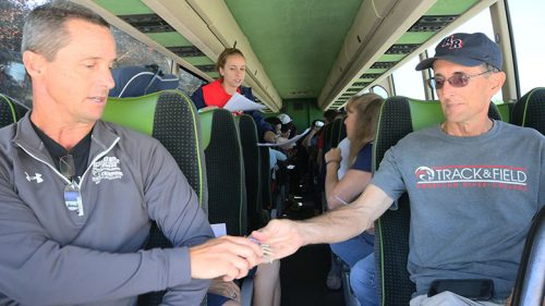 Coach Rick Anderson for the men's cross country team (right) and assistant coach Jim Howard sitting upfront on the team's travel bus for their cross country meet at the racecourse, Lou Vasquez, in Golden Gate Park, San Francisco on Sept. 22. (Photo by Cheyenne Drury)