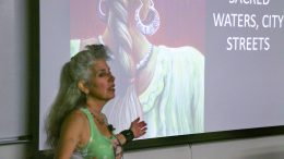 Juana Alicia delivers her presentation at American River College (Photo by James Saling)