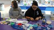 American River College students support Life is Worth the Walk by making bracelets to support the wellness in the  Cafeteria on Oct. 20. (Photo by Cierra Quintana)