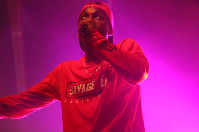 """Hopsin performs on stage for his tour """"SavageVille,"""" at Ace of Spades in downtown Sacramento 1417 R St, on Sat. Oct. 8. The rapper demonstrated his spontaneity when he jumped off of the stage, and with the support of his fans, stood up and continued to rap. (Photo by Cheyenne Drury)"""