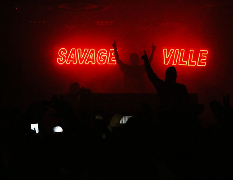 "Hopsin performs on stage for his tour ""SavageVille,"" at Ace of Spades in downtown Sacramento 1417 R St, on Sat. Oct. 8. The rapper demonstrated his spontaneity when he jumped off of the stage, and with the support of his fans, stood up and continued to rap. (Photo by Cheyenne Drury)"