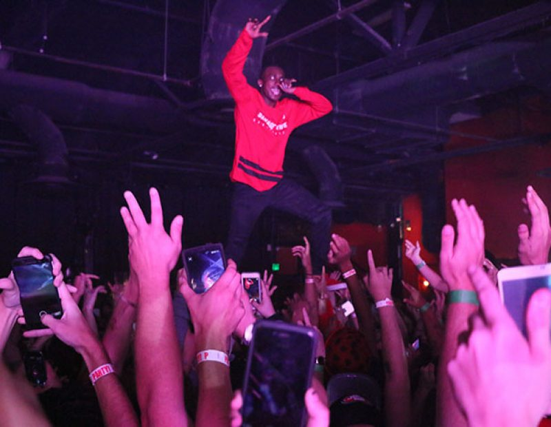 "Rapper Hopsin performs while crowd surfing at Ace of Spades in Sacramento, California on Oct. 8 as part of his ""SavageVille"" tour (Photo by Cheyenne Drury)"