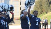 American River College Beavers, Damen Wheeler, Jr. Daliceo Calloway, Moises Valcarcel, and Anthony Luke raise their helmets during the game against San Mateo on Oct. 1.  (photo by Lidiya Grib)