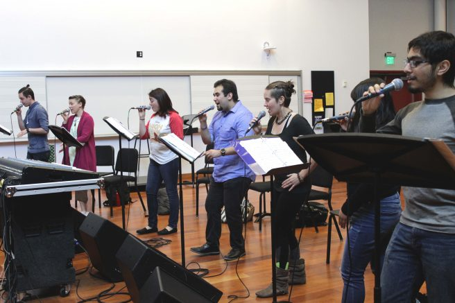 The ARC Vocal Jazz Ensemble singers Cody Quackenbush, Madalyn Parker, Jenna Magaziner, Gabe Catabran, Kate Janzen, Serena Chao and Daniel Avanto rehearse for the national Jazz Education Network that they will attend in New Orleans in January. (Photo by Lidiya Grib)