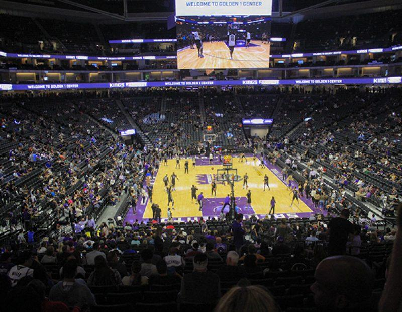 "Fans watch as the Sacramento Kings warm up before a friendly exhibition at ""Fan Fest"" in the Golden 1 Center in Sacramento, California (Photo by Luis Gael Jimenez)"