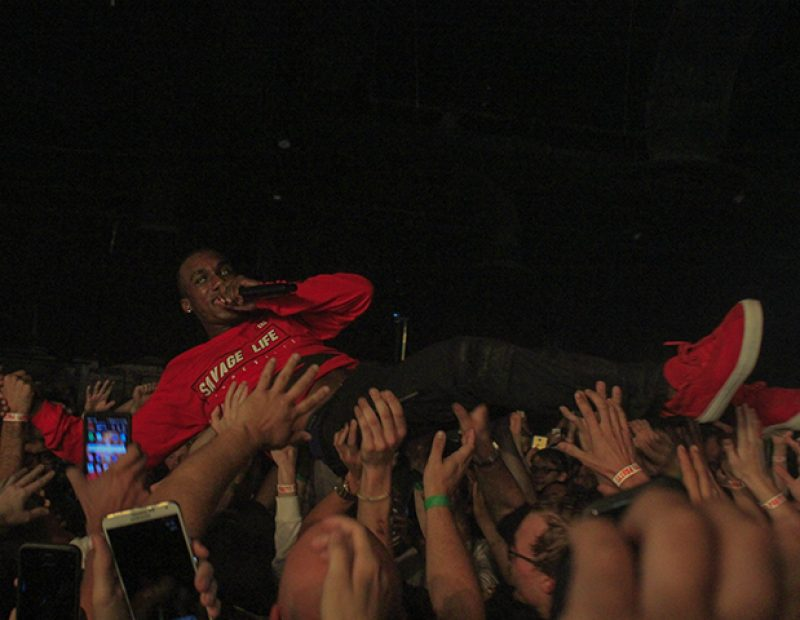 "Rapper Hopsin performs while crowd surfing at Ace of Spades in Sacramento, California on Oct. 8 as part of his ""SavageVille"" tour (Photo by Luis Gael Jimenez)"