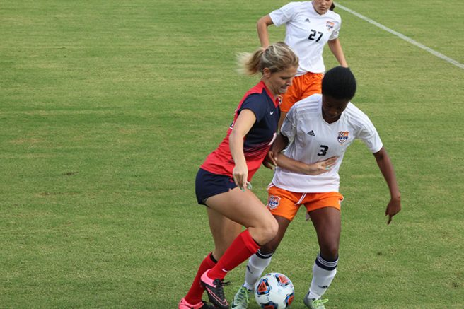 American River College forward Savannah Watson battles with Cosumnes River College defender Taylor Thomas during a game on Oct. 28, 2016. ARC lost 2-0. (Photo by Mack Ervin III)
