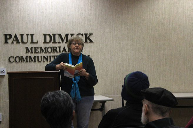 """ARC professor Lois Ann Abraham reading from her newly published book """"Tina Goes to Heaven"""" at Arden Dimick library on Dec. 3. (Photo by Lidiya Grib)"""