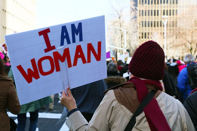 "A woman holds up a sign at ""Women's March on Sacramento,"" a nationwide peaceful gathering to show support for all marginalized peoples in downtown Sacramento on Saturday. The event was coordinated by Jessica Browning, Sarah Linder, Annie Adams, and Sita Wilson Stukes. (Photo by Cheyenne Drury)"