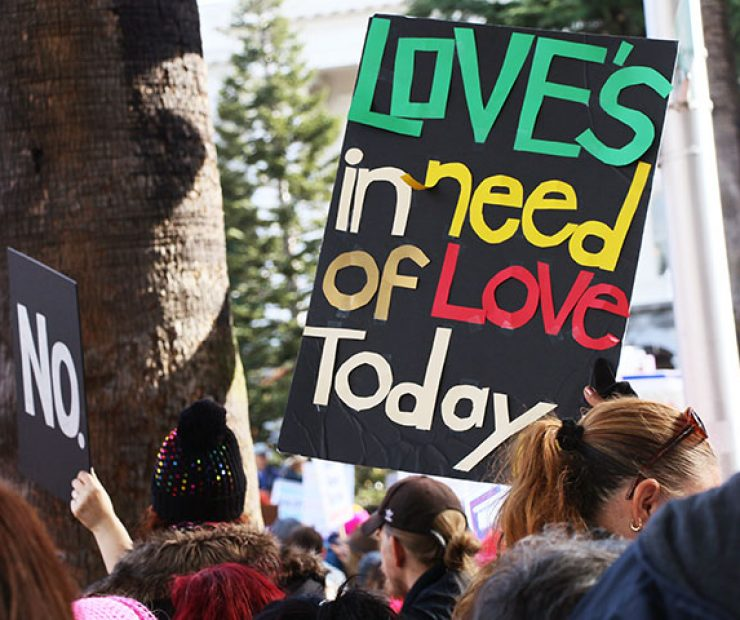 "A person holds up a sign at ""Women's March on Sacramento,"" a nationwide peaceful gathering to show support for all marginalized peoples in downtown Sacramento on Saturday. The event was coordinated by Jessica Browning, Sarah Linder, Annie Adams, and Sita Wilson Stukes. (Photo by Cheyenne Drury)"