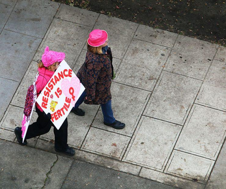 "A women wears a sign at ""Women's March on Sacramento,"" a nationwide peaceful gathering to show support for all marginalized peoples in downtown Sacramento on Saturday. The event was coordinated by Jessica Browning, Sarah Linder, Annie Adams, and Sita Wilson Stukes. (Photo by Cheyenne Drury)"