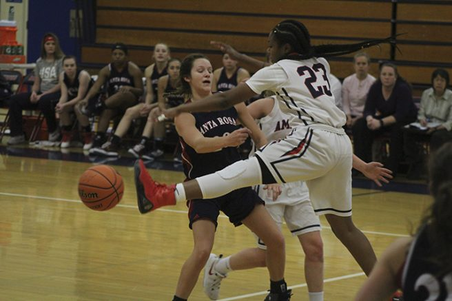 American River College guard Alana Myers blocks a pass during a game against Santa Rosa Junior College on Jan. 27. The Beavers picked up their 15th win of the season 62-44. (Photo by Mack Ervin III)