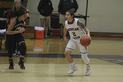 American River College guard Rauline Martinez is marked by Santa Rosa forward LaDonna Saint Louis while dribbling the ball upcourt during a game on Jan. 27, 2017 at ARC. ARC won the game 62-44. (Photo by Mack Ervin III)