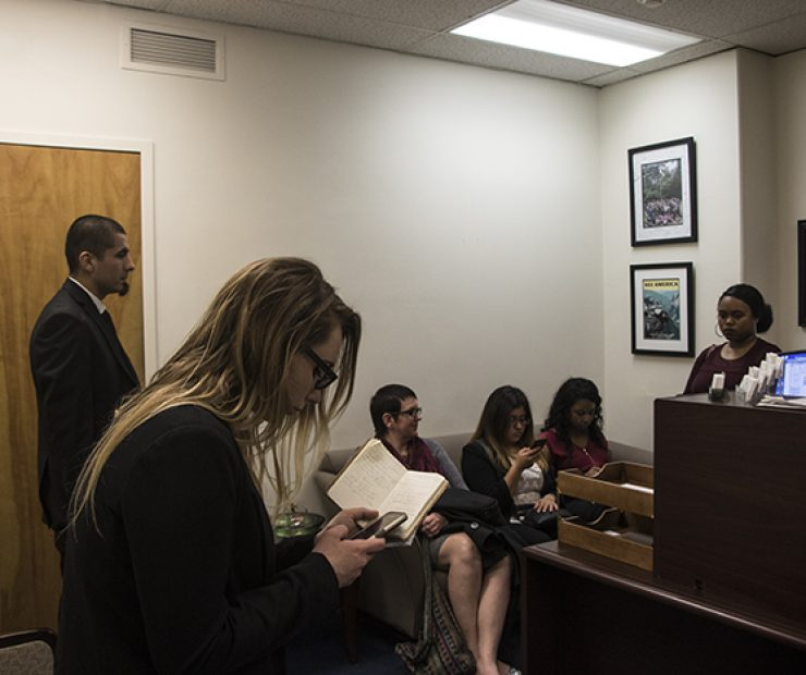 The students wait outside the office of Assemblymember Ken Cooley. They are going over their notes and practicing what they are going to say. (Luis Gael Jimenez)