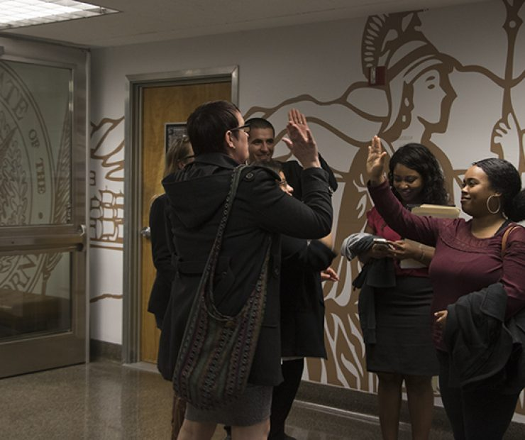 The student senators congragulate one another after their meeting with Amanda Kirchner. They are now looking for other potential assemblymembers to lobby. (Photo by Luis Gael Jimenez)