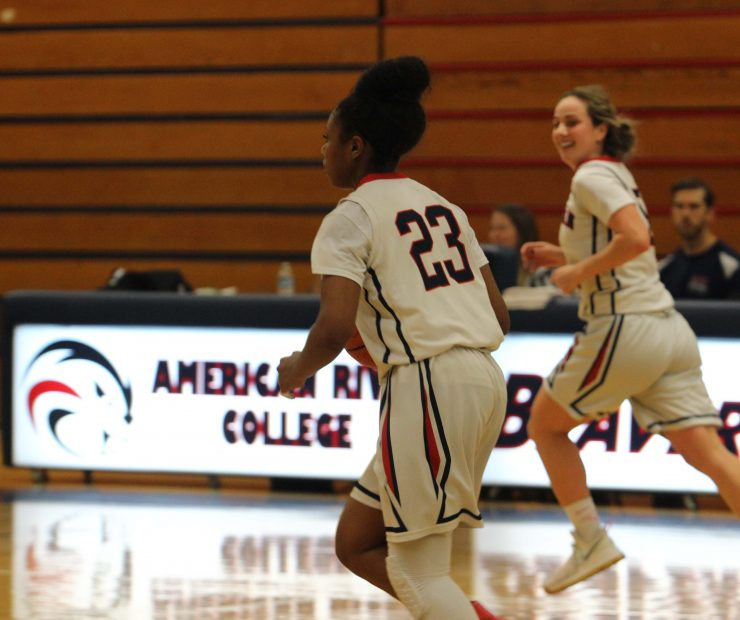 ARC players Alana Myers, a guard, and Jennifer Manduca, a guard, run across the court. (photo gallery by Lidiya Grib)