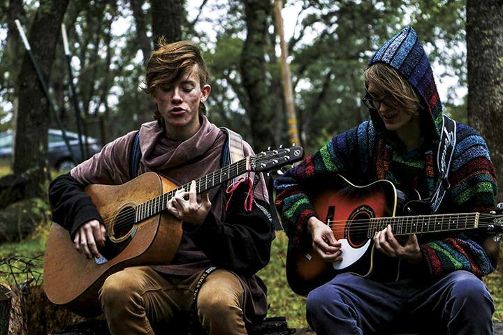 Bryce Mondul (left) and Justin Carter practice one of their songs at Georgio Klironomos' ranch in Placerville, California on Oct. 27, 2016. (Photo by Luis Gael Jimenez)