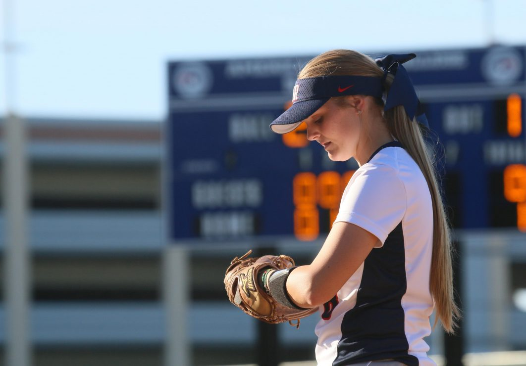 ARC softball infield Sierra Cryderman stands on the field during the game. (Photo Gallery by Lidiya Grib)