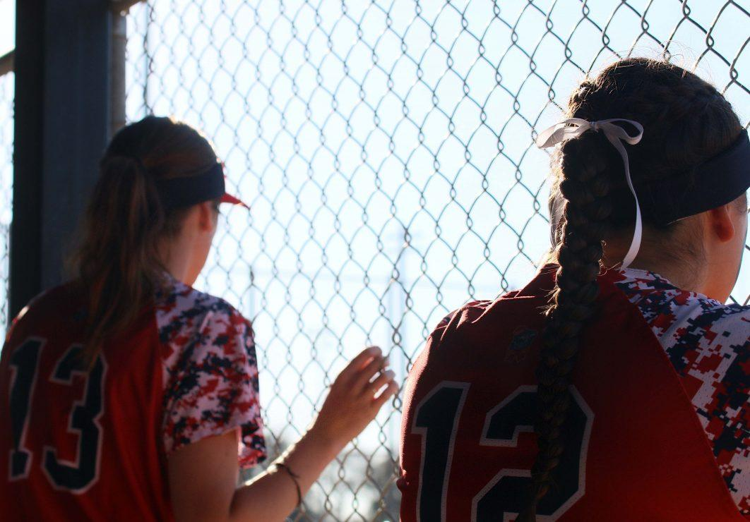 Santa Rosa Junior College teammates Elizabeth Brown and Haley Millerick look out at the game. (photo gallery by Lidiya Grib)