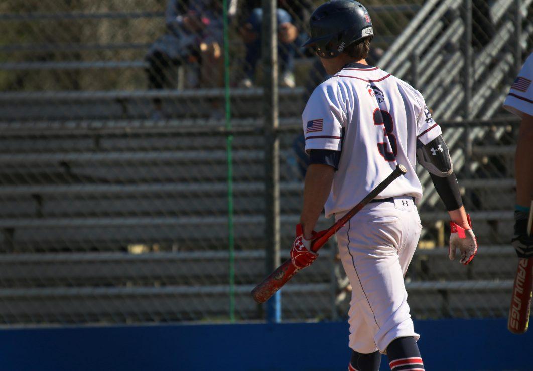 ARC batter Tyler Swank walks to first base.