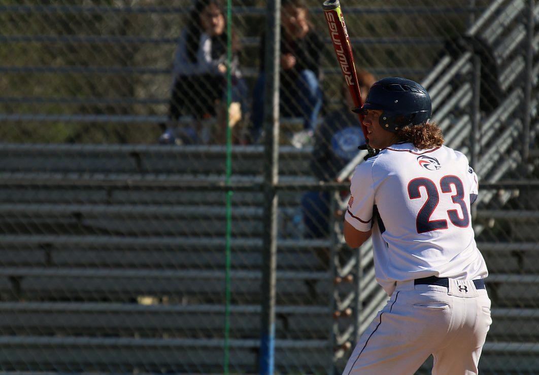 ARC batter Alex Dodd stands on first base.