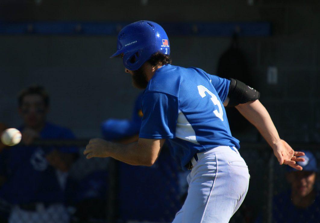 Luke Knoble runs toward home base.
