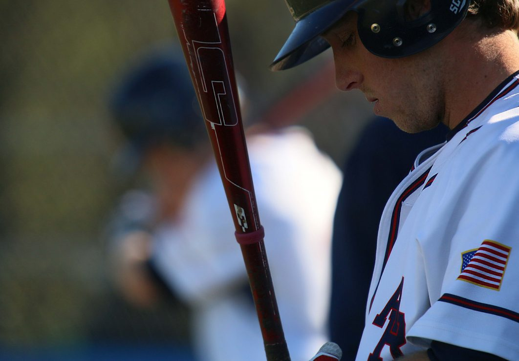 ARC baseball player holds the bat.
