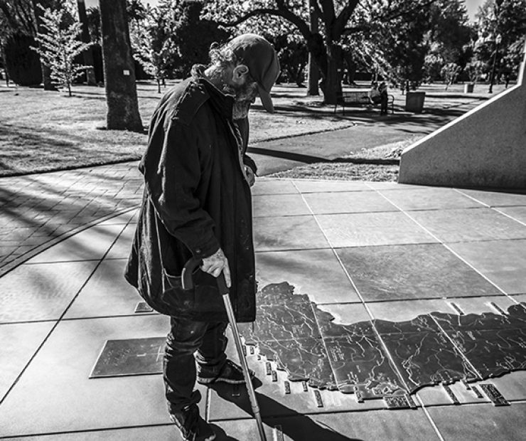 Larry Gene King stands over a map of Vietnam at the California Vietnam Veterans Memorial in Sacramento, California on March 31. King served two tours in Vietnam and was captured and held in the Mekong Delta as prisoner of war for an undisclosed amount of time. (Photo by Luis Gael Jimenez)