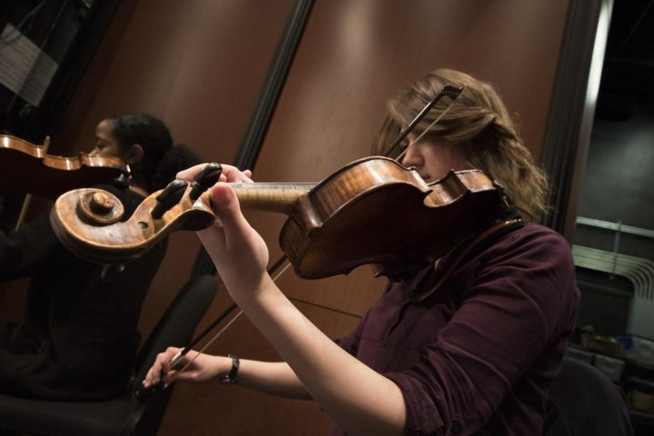 Raluca Ilies plays her violin on Mar. 8 at American River College.(Photo by Ashley Hayes-Stone)