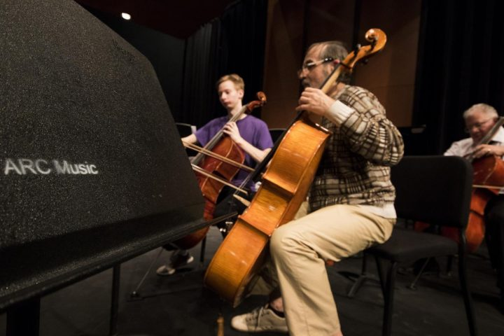 Yuriy Klyushnik and Elgin Farschman practices the cello together on Mar. 8 at American River College.(Photo by Ashley Hayes-Stone)