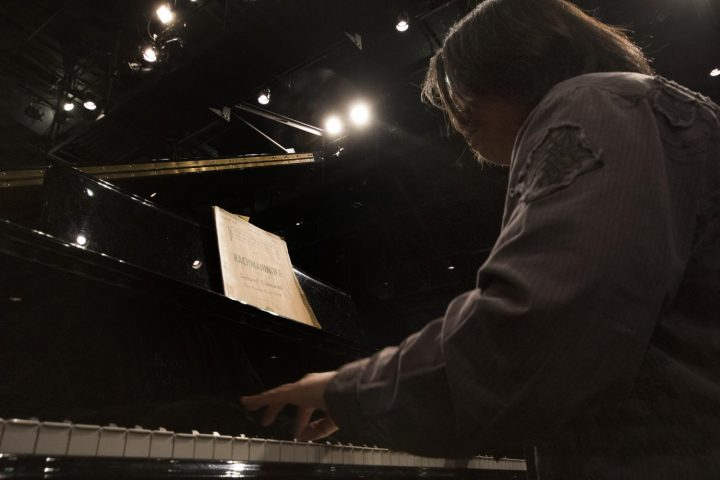 Kyle Cremat plays the piano during rehearsal on Mar. 8 at American River College.(Photo by Ashley Hayes-Stone)