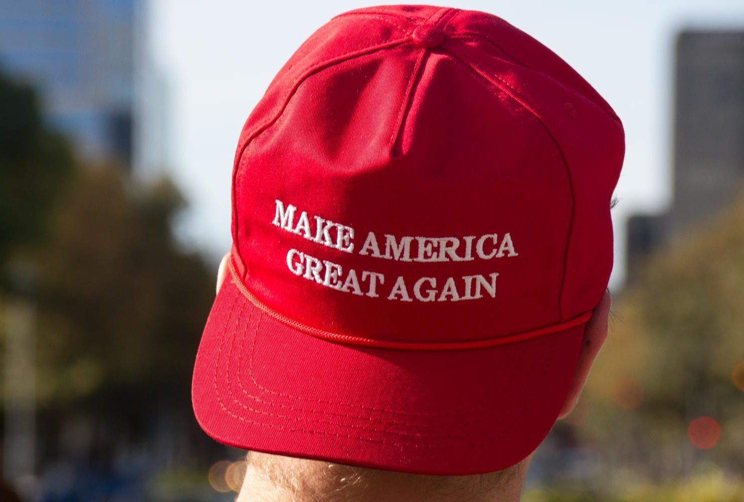 "A demonstrator wearing a ""Make America Great Again"" hat at the ""Turn California Red"" conservative rally at the Sacramento State Capitol on Nov. 4, 2018. (Photo by Patrick Hyun Wilson)"