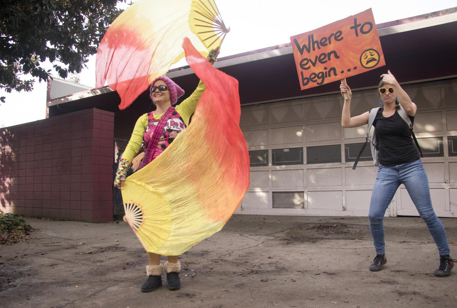 "A demostrator dances to the side as another holds a sign that reads ""Where to even begin…""while indivuals were marching to the California State Capitol during the third annual Women's March in Sacramento, Calif. on Jan. 19, 2019. Participants of the Sacramento Women's March arrived at Southside Park at 10 a.m. and begun to march at 10:30 a.m. to the California State Capitol."