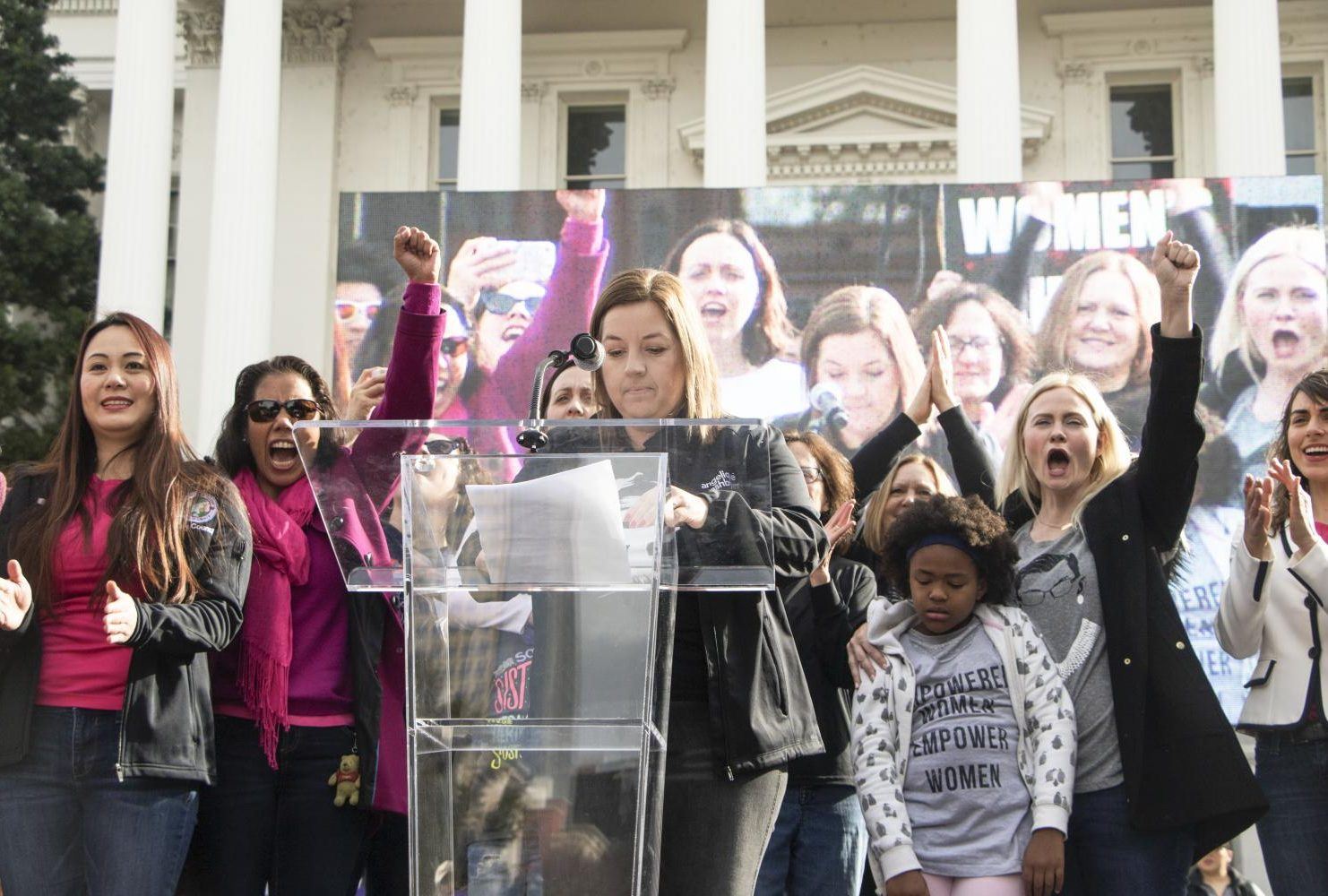 Sacramento councilwoman Angelique Ashby reads off the names of women who were recently elected to boards and councils in the Sacramento area while some of whom joined her on stage at the steps of the California State Capitol during the third annual Sacramento Women's March on Jan. 19, 2019.