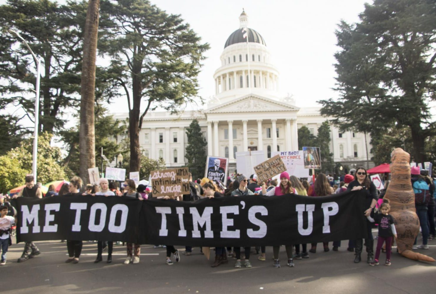 "Demostrators hold up a banner that reads ""Me Too Time's Up in front of the California State Capitol during the third annual Women's March in Sacramento, Calif. on Jan. 19, 2019. The number of attendance decrease from last year's event according to Sacramento Police 10,000 individuals participated in the march than the  estimasted 36,000 marchers that attended last year."