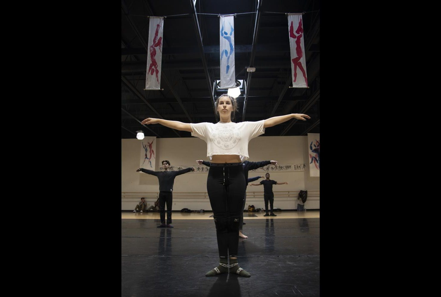 Cat Vandervan, teaching assistant, leads warm ups in the American River College dance studio during Dance Production: Studio & Stage, on Feb. 6, 2019. (Photo by Ashely Hayes-Stone)